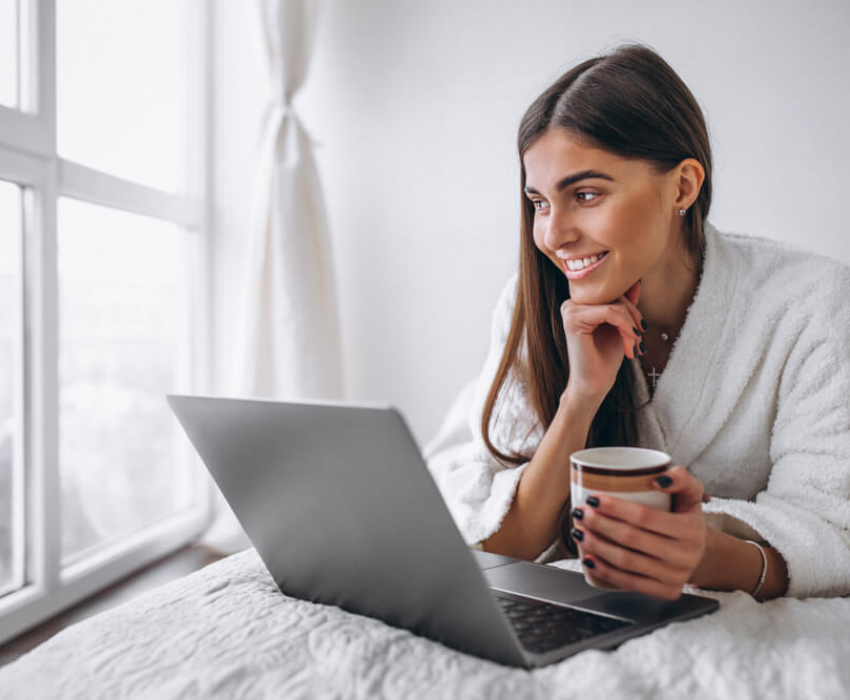 woman enjoying reading laptop
