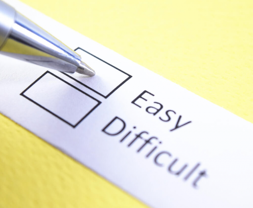 selecting easy over difficult selection on paper with pen