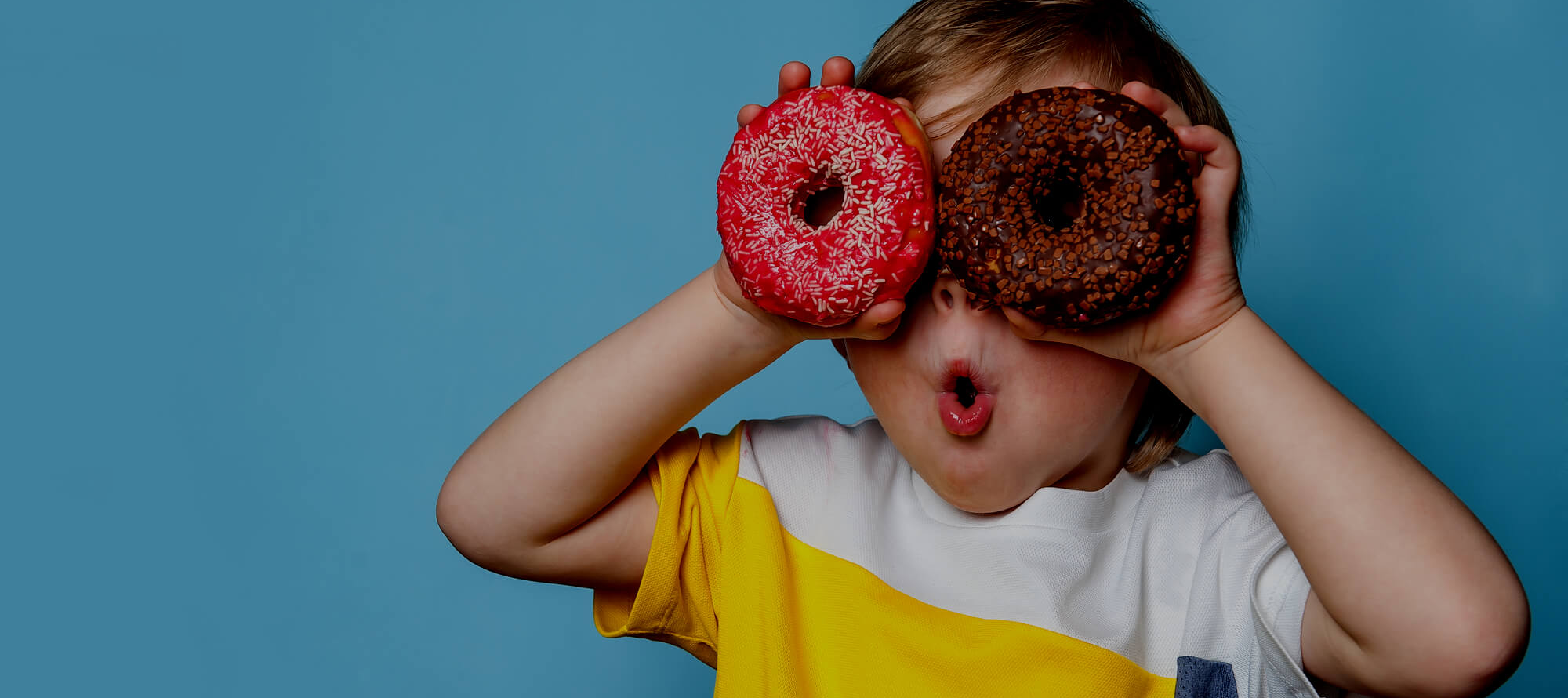 boy with donut eyes